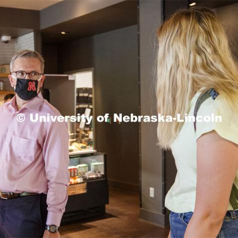Chancellor Ronnie Green talks with Lauren Dunn, a junior from Omaha, as he waits for his coffee at the Nebraska Union Starbucks. First day for in-person learning for the fall semester.  August 24, 2020. Photo by Craig Chandler / University Communication.