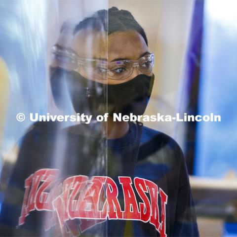 Kyra Baptiste of Topeka, KS, is reflected in an acrylic divider in her Chemistry 105 lab. First day for in-person learning for the fall semester. August 24, 2020. Photo by Craig Chandler / University Communication.