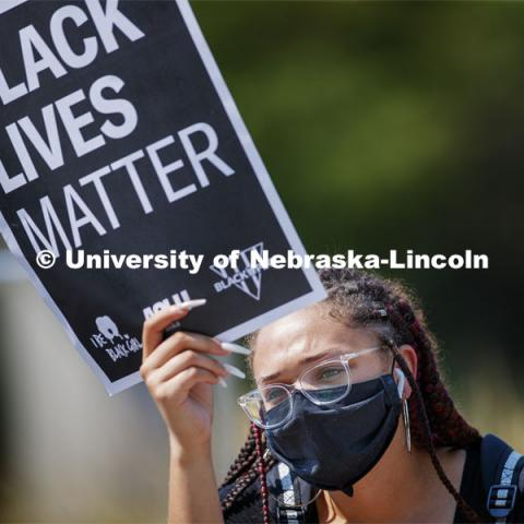 Kiara Williams holds a Black Lives Matter sign at the sit-in sponsored by the Black Student Union to draw attention to the shooting of Jacob Blake in Kenosha, WI. August 25, 2020. Photo by Craig Chandler / University Communication.