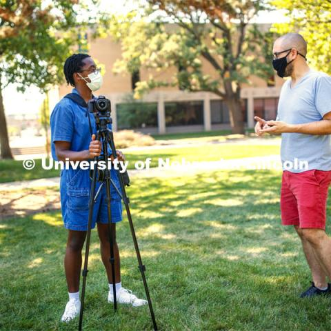 Walker Pickering explains camera settings to a student in the PHOT 161 - Photography for Non-majors class. City Campus. August 26, 2020. Photo by Craig Chandler / University Communication.