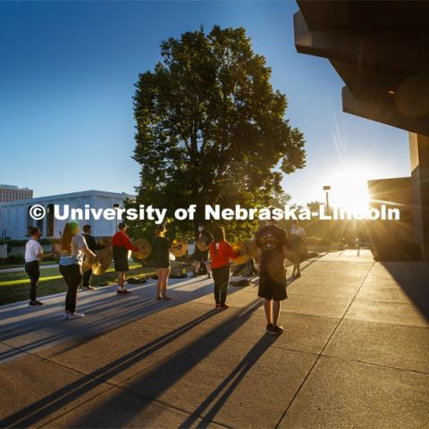 A sunrise serenade as the cymbals and bass line of the Cornhusker Marching Band practices outside Kimball Music Hall Tuesday morning, September 2, 2020. Photo by Craig Chandler / University Communication.