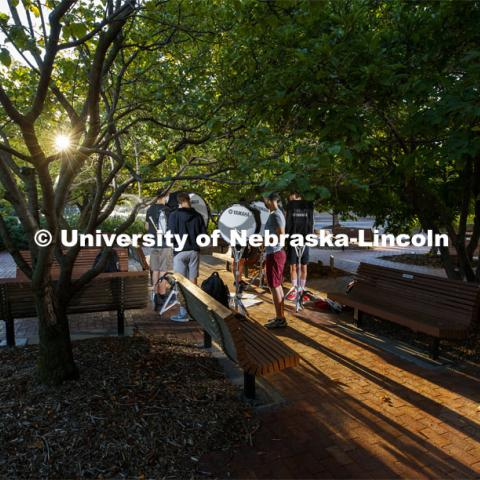 The bass line practices under the trees outside the Lied Center. A sunrise serenade as the cymbals and bass line of the Cornhusker Marching Band practices outside Kimball Music Hall Tuesday morning, September 2, 2020. Photo by Craig Chandler / University Communication.