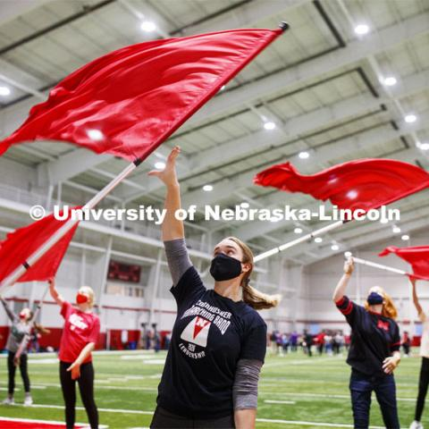 Michaela Smith and the flag team are out for an early morning spin as the Cornhusker Marching Band practices in Cook Pavilion. September 10, 2020. Photo by Craig Chandler / University Communication.