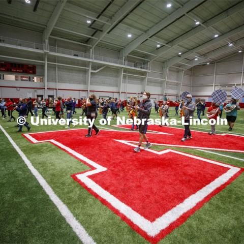 Cornhusker Marching Band practice in Cook Pavilion. One third of the marching band meets each morning at Cook to practice as the rest of the band practices in other locations where they can properly distance. September 10, 2020. Photo by Craig Chandler / University Communication.