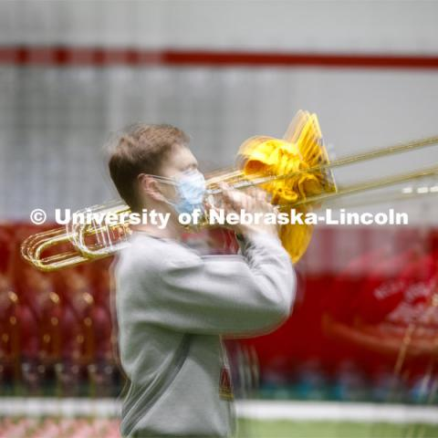 Hayden Fuelberth marches in the multiple exposure image. Cornhusker Marching Band practice in Cook Pavilion. September 10, 2020. Photo by Craig Chandler / University Communication.