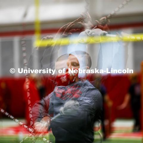 Drum Major Jacob Coughlin practices his mace twirl in a multiple exposure image. One third of the marching band meets each morning at Cook to practice as the rest of the band practices in other locations where they can properly distance. Cornhusker Marching Band practice in Cook Pavilion. September 10, 2020. Photo by Craig Chandler / University Communication.