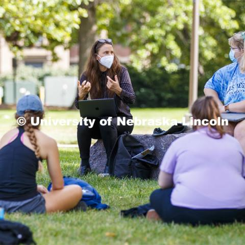 Assistant Professor Katie Anania teaches her Visualizing Crisis: Food, Water and Biopolitics class in the shade of a tree outside of Woods Art Building. On campus. September 15, 2020. Photo by Craig Chandler / University Communication.