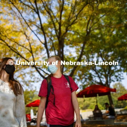 Brooklyn Guess, left, and Nicole Marienau walk through the plaza outside the Nebraska Union while wearing their masks on city campus. September 21, 2020. Photo by Craig Chandler / University Communication.