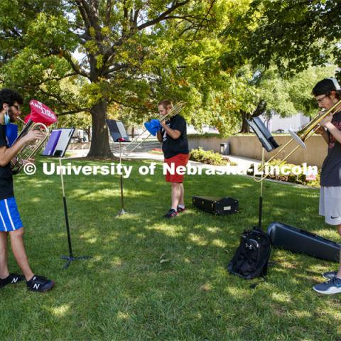 Max Jabir, freshman from Chicago, improvised a gritty choice for the glory of his music as he practices with two other musicians in the Sheldon Gardens. September 22, 2020. Photo by Craig Chandler / University Communication.