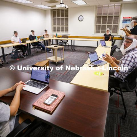 Jordan Soliz, sitting at right, teaches his Social Identity and Intergroup Communication course. All those in the class wear special face shields to aid a hearing-impaired student. September 23, 2020. Photo by Craig Chandler / University Communication.