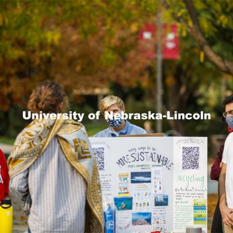 ASUN's Environmental Sustainability Committee students have a table set up outside the Nebraska Union and talk to other students about recycling. City Campus. October 5, 2020. Photo by Craig Chandler / University Communication.