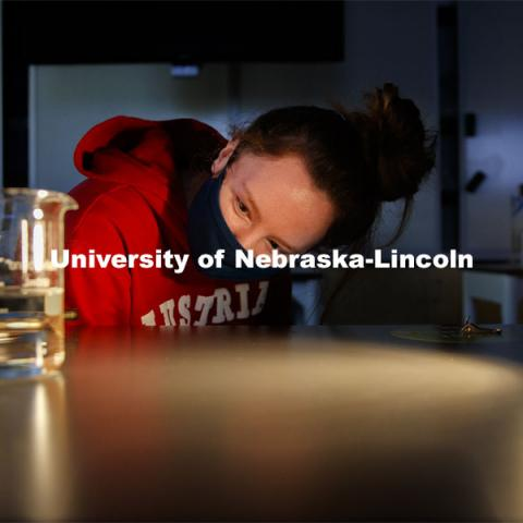 Raegan Hoyle, freshman from Fremont, Nebraska, watches for a reaction to light from her spinach leaf punches in a photosynthesis experiment. LIFE 120L - Fundamentals of Biology I laboratory. October 6, 2020. Photo by Craig Chandler / University Communication.