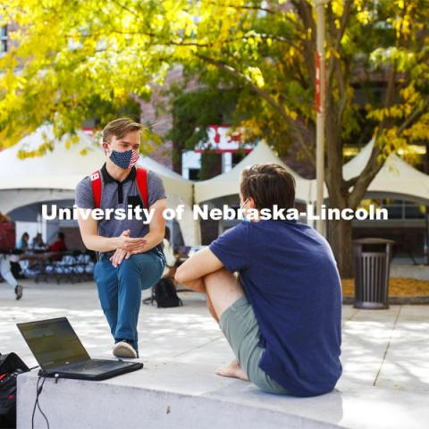 Ian Maltas, a junior from Lincoln, and Uri Harding, a junior from Omaha, talk during the noon hour outside the Nebraska Union. City Campus. October 7, 2020. Photo by Craig Chandler / University Communication.