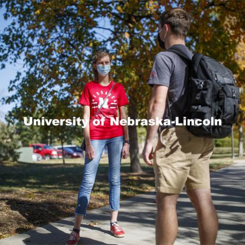 Students crossing campus. East Campus photo shoot. October 13, 2020. Photo by Craig Chandler / University Communication.