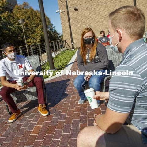 Students sit on the new patio along the south side of the Nebraska East Union. East Campus photo shoot. October 13, 2020. Photo by Craig Chandler / University Communication.