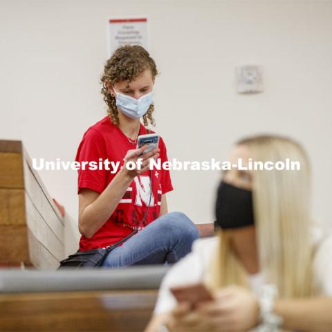 Students checking their phones inside the remodeled Nebraska East Union. East Campus photo shoot. October 13, 2020. Photo by Craig Chandler / University Communication.