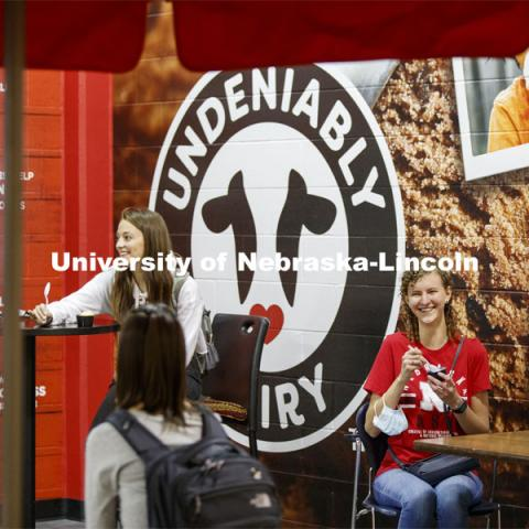 Students enjoy ice cream while social distancing inside the Dairy Store. East Campus photo shoot. October 13, 2020. Photo by Craig Chandler / University Communication.