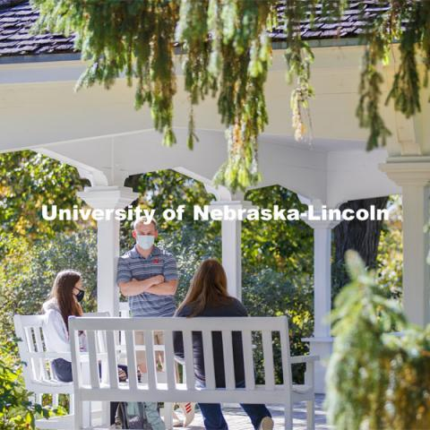 Students enjoy the afternoon on Perin Porch on east campus. East Campus photo shoot. October 13, 2020.  Photo by Craig Chandler / University Communication