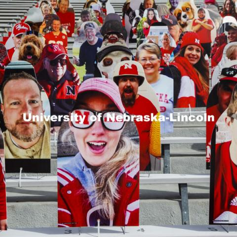 Cardboard cutouts of fans fill the stands in Memorial Stadium. Cornhusker Marching Band, Cheer Squad and Homecoming Royalty met in the empty Memorial Stadium to record performances that will air during Husker football games on the Big 10 Network during the upcoming season. October 18, 2020. Photo by Craig Chandler / University Communication.