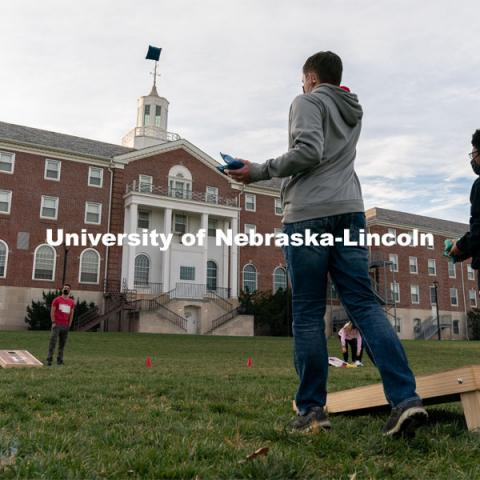 Students toss beanbags during the ASUN Cornhole Competition at the Cather-Pound Greenspace on Wednesday, Oct. 28, 2020, in Lincoln, Nebraska. Photo by Jordan Opp for University Communication.