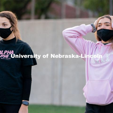 Kappa Kappa Gamma's Liz Stacy (right) reacts to an errant throw during the ASUN Cornhole Competition at the Cather-Pound Greenspace on Wednesday, October 28, 2020, in Lincoln, Nebraska. Photo by Jordan Opp for University Communication.