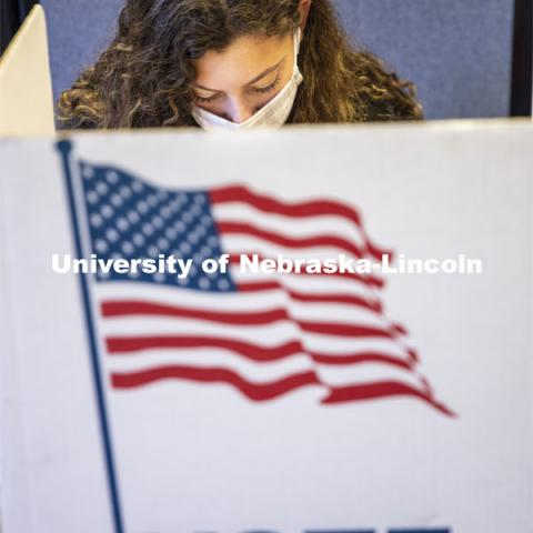 Grace Carey, a freshman from Bellevue, Nebraska, votes in her first election. Voting in the Nebraska Union for the 2020 Presidential Election. November 3, 2020. Photo by Craig Chandler / University Communication.