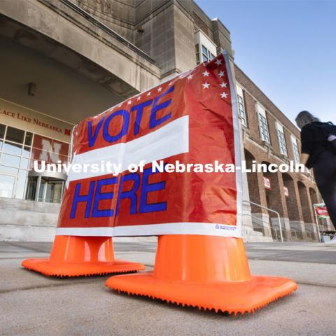 "A ""Vote Here"" sign directs people into the Nebraska Union. Voting in the Nebraska Union for the 2020 Presidential Election. November 3, 2020. Photo by Craig Chandler / University Communication."