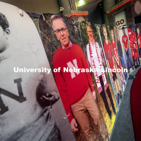 Chancellor Ronnie Green is in great company in the tunnel walk with George Flippin (left) and Ronnie's wife, Jane, are among the nearly 180 full-sized fan cutouts that line the Tunnel Walk carpet in North Stadium. Flippin was the first Black University of Nebraska football player (1891-1894). More than 6,000 corrugated plastic cutouts fill the lower level of east stadium, the tunnel walk, and part of north stadium to remind the Huskers who has the Greatest Fans in College Football. November 12, 2020. Photo by Craig Chandler / University Communication.