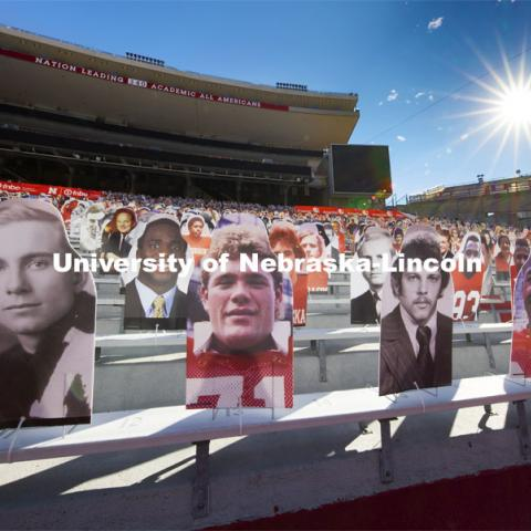 Nearly 100 Husker Academic All-Americans line the Memorial Stadium bleachers where the Cornhusker Marching Band normally plays (section 10) in the East Stadium. The university leads the nation with 340 student-athletes having earned Academic All-American status. More than 6,000 corrugated plastic cutouts fill the lower level of east stadium, the tunnel walk, and part of north stadium to remind the Huskers who has the Greatest Fans in College Football. November 12, 2020. Photo by Craig Chandler / University Communication.