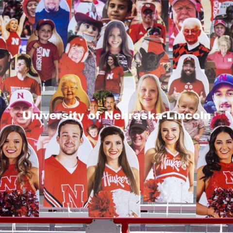 Members of the Husker Cheer Squad have front row seats for the home games. More than 6,000 corrugated plastic cutouts fill the lower level of east stadium, the tunnel walk, and part of north stadium to remind the Huskers who has the Greatest Fans in College Football. November 12, 2020. Photo by Craig Chandler / University Communication.