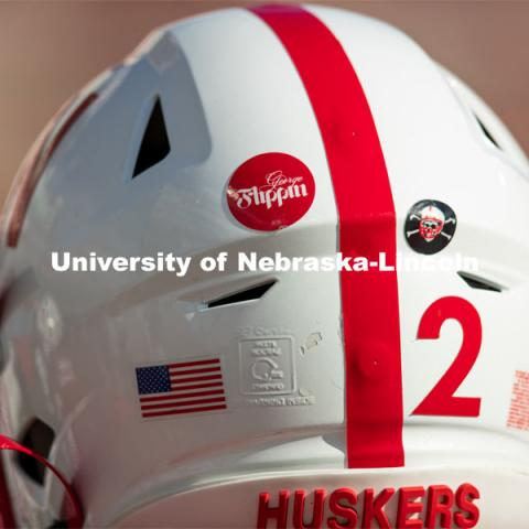 Helmet stickers honor George Flippin. George Flippin attended the University of Nebraska from 1891 to 1894. He was the first African-American football player for the University. Missouri refused to play a scheduled football game, forfeiting 1-0 because of Flippin's presence on the team. He was inducted into the Nebraska Football Hall of Fame in 1974. Team Huddle. Football vs Penn State. November 14, 2020. Photo by Scott Bruhn / Husker Athletics