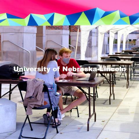 Students study outside of the Nebraska Union under the tents installed to help with social distancing. November 18, 2020. Photo by Daniela Chavez for University Communication.