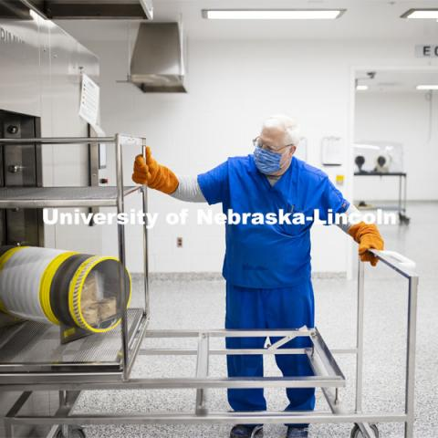 Robert Schmaltz, manager of the Gnotobiotic Mouse Facility, removes a sterilized supply cylinder from an autoclave. Photos of the new Gnotobiotic Mouse Facility - Nebraska Food for Health Center. November 19, 2020. Photo by Craig Chandler / University Communication.