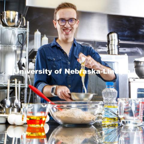 William Wilton, a sophomore in Child, Youth and Family Studies, in the Leverton Hall kitchen. Photo for NU Foundation Pride of Place Magazine. November 23, 2020. Photo by Craig Chandler / University Communication.