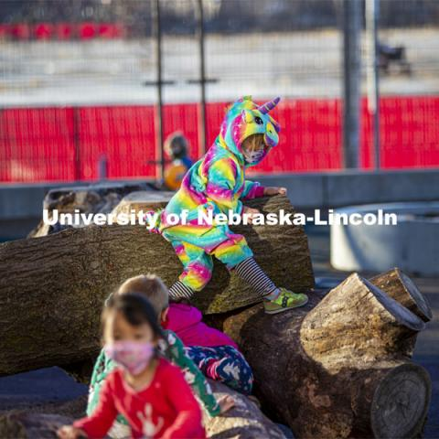 Children at the University of Nebraska-Lincoln Children's Center spent time on pajama day climbing on actual trees placed on the playground. December 7, 2020. Photo by Craig Chandler / University Communication.