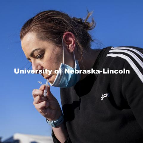 Jessica Calvi, a research assistant professor with the Nebraska Athletic Performance Lab, demonstrates the new saliva-based COVID test for all students, faculty and staff on campus. January 4, 2021. Photo by Craig Chandler / University Communication.