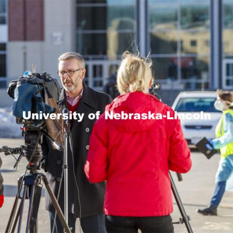 Chancellor Ronnie Green talks with media and takes his COVID-19 saliva test Tuesday afternoon at the East Stadium loop site.  January 19, 2021. Photo by Craig Chandler / University Communication