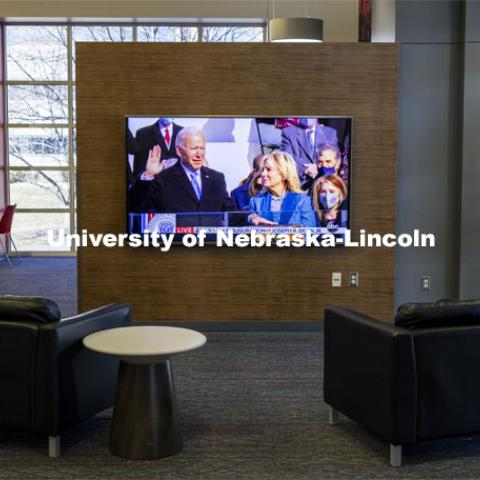 With students still on winter break, the Nebraska Union was nearly empty as the inauguration of President Biden was on a lone television screen. January 20, 2021. Photo by Craig Chandler / University Communication.