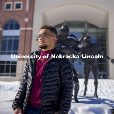 Drake Keeler is a journalism major who is leading the Daily Nebraskan's Black Lives Matter project and telling more Black stories on campus. He hopes to continue that work in his future career. Drake is a junior in journalism, specializes in sports writing. He is posing in front of Memorial Stadium in the snow. Photo for a Black History Month feature. January 27, 2021. Photo by Craig Chandler / University Communication.