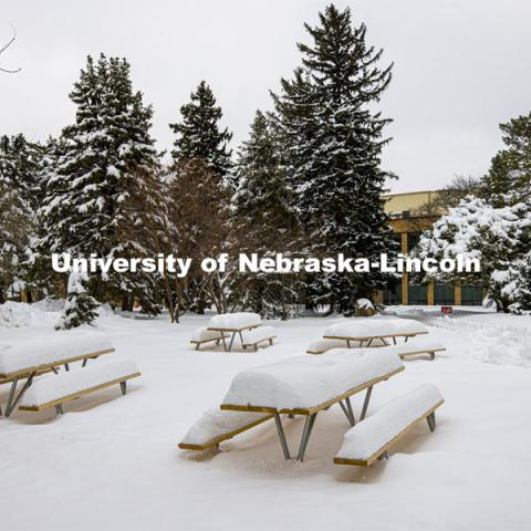 "The picnic tables outside of the Nebraska East Union on East Campus are covered in more than 14"" of snow from the snowstorm on Monday. January 28, 2021. Photo by Craig Chandler / University Communication."