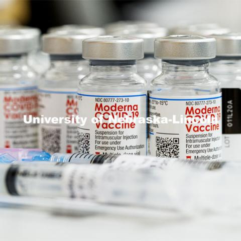 Syringes and vials of Moderna COVID-19 Vaccine. University Health Center and UNMC College of Nursing students, staff, and faculty receive their first COVID vaccine. January 29, 2021. Photo by Craig Chandler / University Communication.