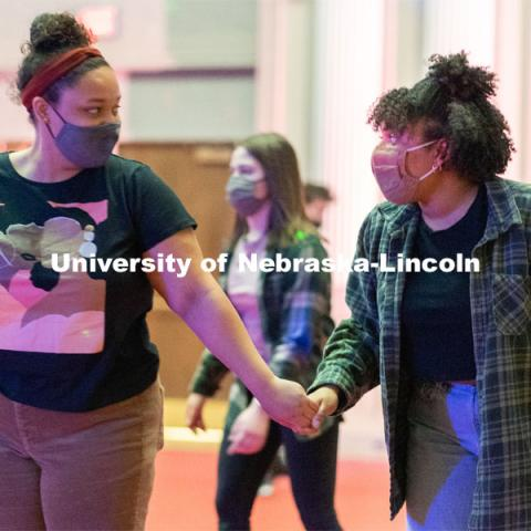 Students hold hands as they skate during the Club 80 Roller Skating Event in the Nebraska Union Ballroom on Friday, February 19, 2021, in Lincoln, Nebraska. Photo by Jordan Opp for University Communication.