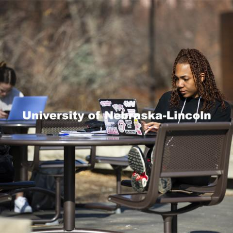 Students studying outside enjoying the warm weather on city campus. March 4, 2021. Photo by Craig Chandler / University Communication.