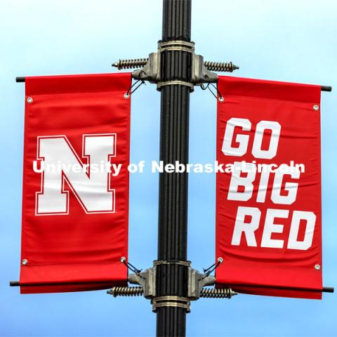 New banners are going up around campus. The N150 banners are being replaced by ones with our N and Go Big Red, alternating with In Our Grit Our Glory. March 25, 2021. Photo by Craig Chandler / University Communication.